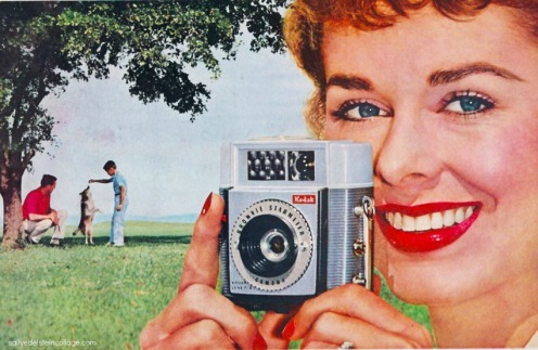 1960s housewife taking a picture with Brownie camera