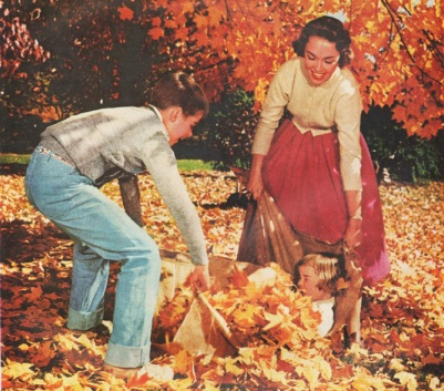 1950s suburban family playing in fall leaves