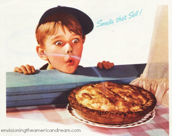 picture little boy smelling pie