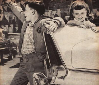 vintage photo 1950s kids looking at cars