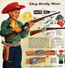 vintage picture boy as cowboy and gun