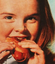 1950s girl eating hot dog