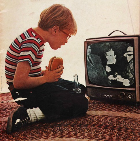 boy watching TV as Oswald shot