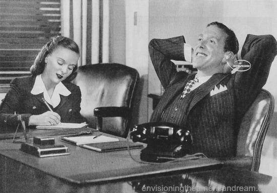 office dictation photo boss at desk secretary