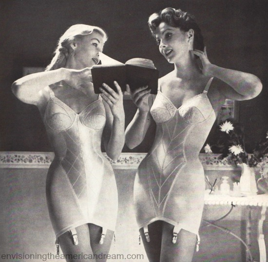 vintage image 2 1950 women in girdles reading a book