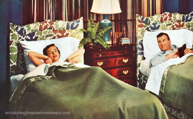 vintage 1950s couple in seperate beds