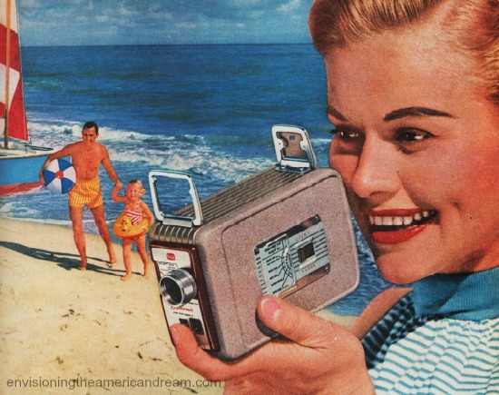 vintage woman with Kodak brownie movie camera at beach