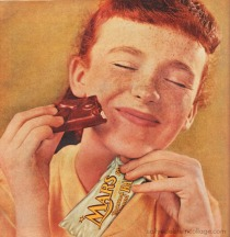 vintage girl eating chocolate Bar