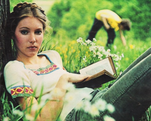 1970s hippy girl reading a book