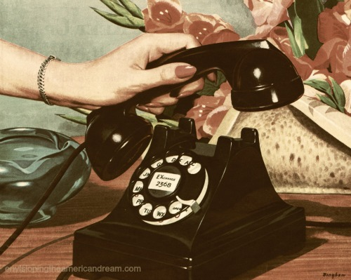 Vintage telephone womans hand picking up receiver