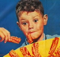 boy eating bacon