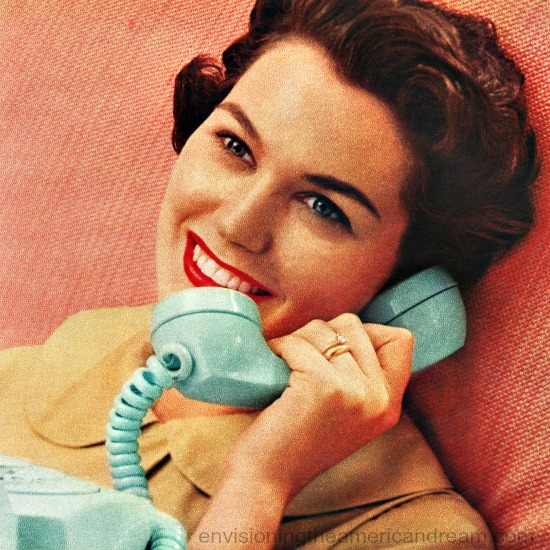 1950s Housewife taliing on telephone