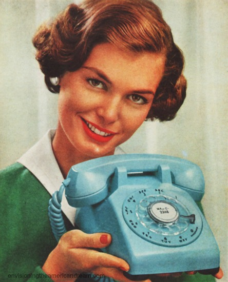 vintage photo housewife holding turquoiuse telephone