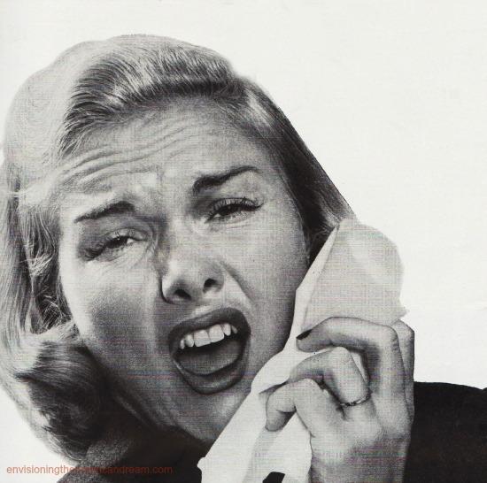 vintage image woman sneezing into tissue