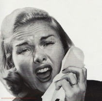 vintage image woman sneezing into tissue