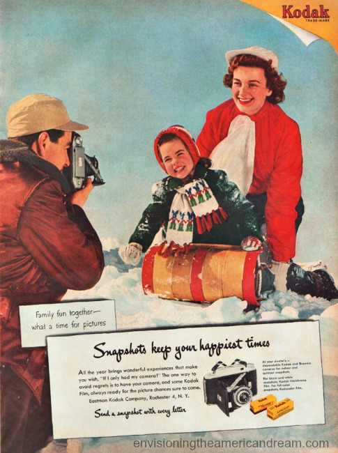 1950s family playing in the snow Vintage Kodak camera ad