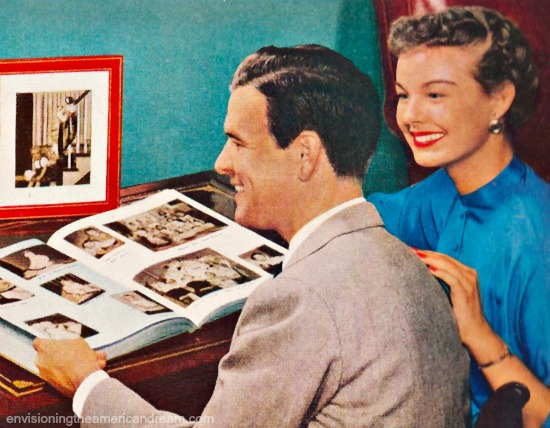 Happy couple looking at scrapbook.