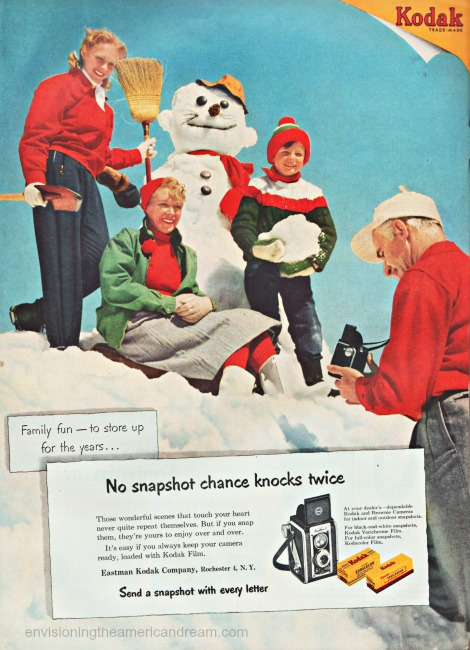 1950s happy family making a snowman Kodak ad