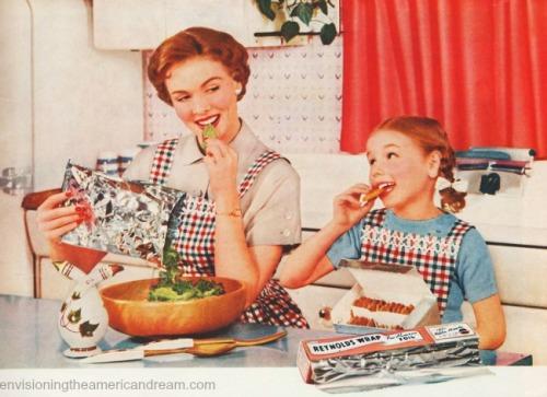 vintage motherand daughter in kitchen 1950s