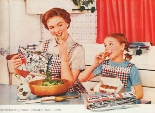 vintage motherand daughter in kitchen 1950s