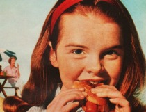 vintage girl eating hot dog