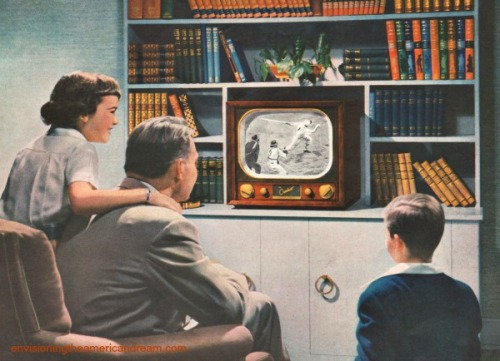 Vintage family 1948 watching TV