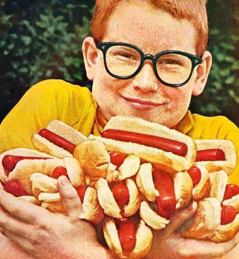 vintage Boy holding hort dogs