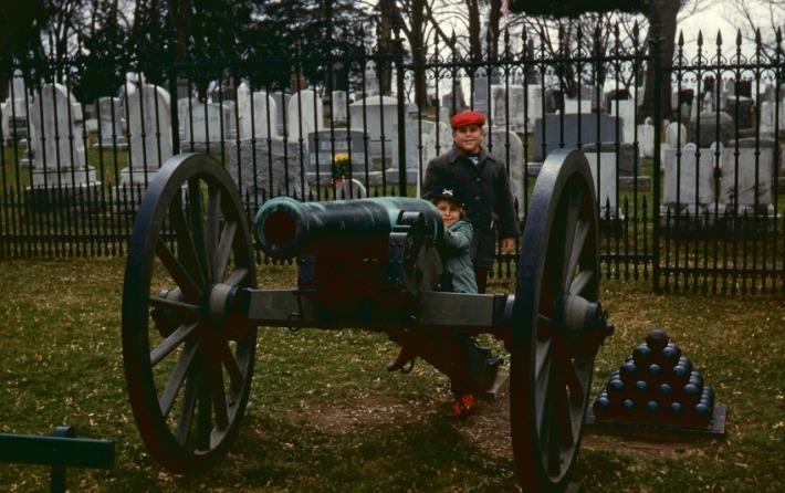 vintage photo children at Gettysburg Battlefield in front of cannon
