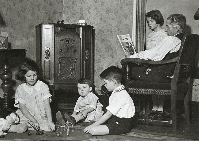 family listening to the radio 1930s