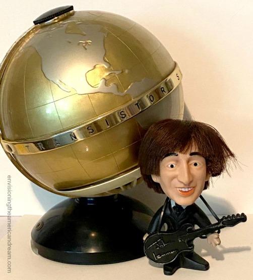 vintage Globe Transistor Radio and John Lennon doll