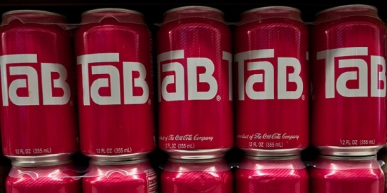 canns of Tab on shelf