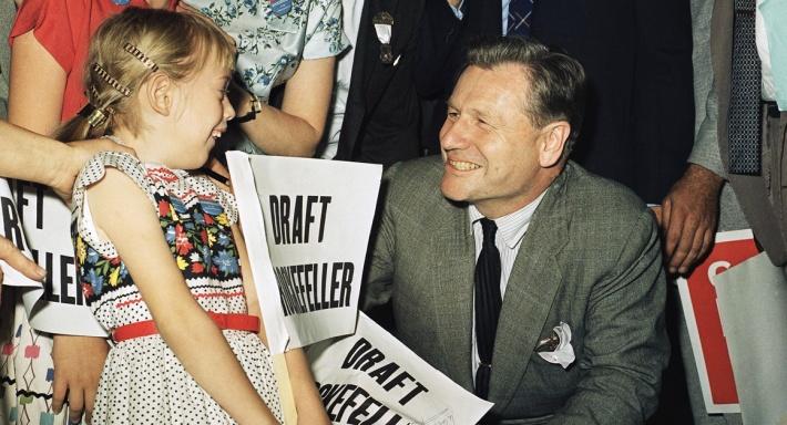 Nelson Rockefeller charms a little girl